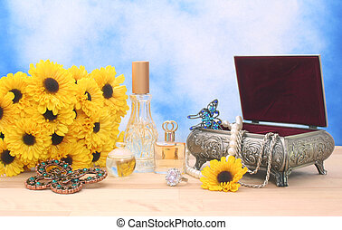 Jewelry and Perfume on Wood With Blue Sky Background