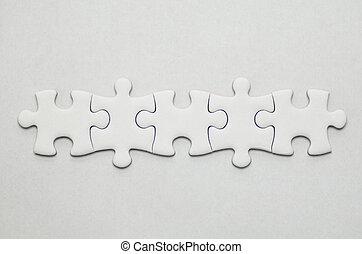 Plain white jigsaw puzzle, on White background.
