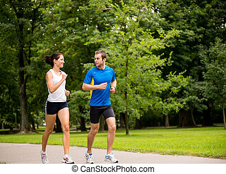 Jogging together - young couple training