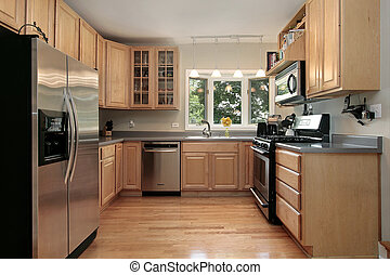 Kitchen in luxury home with oak cabinetry