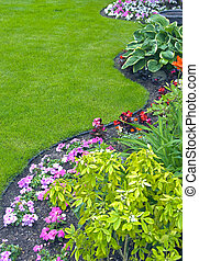 A beautiful landscaped yard and garden with a variety of perennials and annuals.