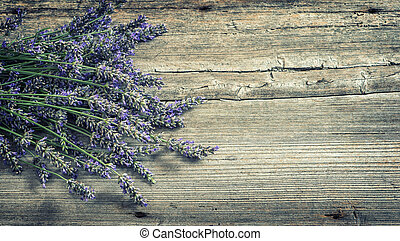Lavender flowers on wooden background. Country style still life