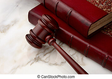 Gavel and law books shot on marble surface
