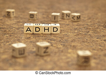 Letters from a game board are used to spell the ADHD
