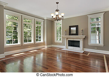Living room in new construction home with fireplace