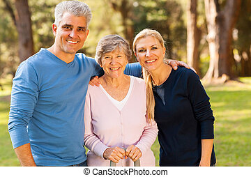mid age couple and senior mother outdoors