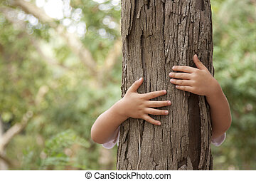 kid hands embracing a tree trunk