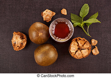 Luo Han Guo aka Monk fruit natural remedy on black background. Powerful healthy sweetener.