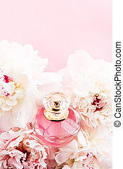 Luxurious fragrance bottle as chic perfume product on background of peony flowers, parfum ad and beauty branding design
