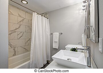 Luxurious master bath with marble tile.
