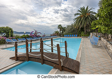 Luxury swimming pool with beautiful views of Lake Garda in Italy