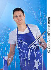 Male Servant Cleaning Glass With Squeegee