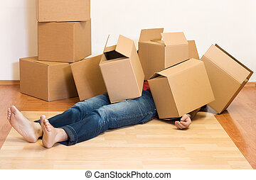 Man covered by lots of cardboard boxes - moving concept
