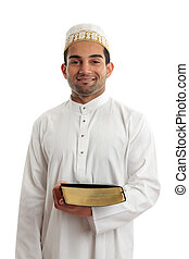 Man holding a book and smiling