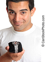 Man holding a chronograph wrist watch
