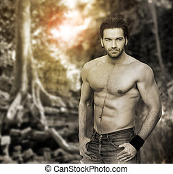 Portrait of a muscular masculine man in outdoor setting with stylized retro vintage look and tones