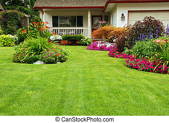 A finely manicured yard show its summer/spring colors.