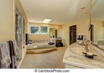 Master marble bathroom interior with walk-in closet