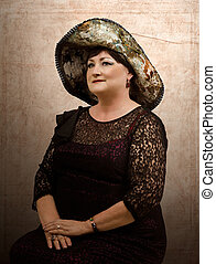 Mature woman in tapestry hat