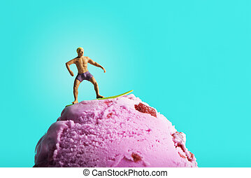 miniature man surfing on an ice cream ball