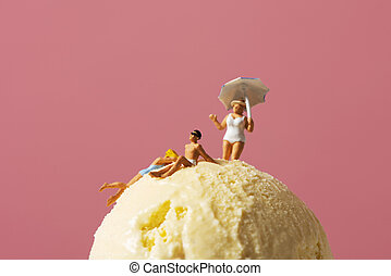 miniature people in swimsuit on an ice cream