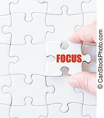 Missing jigsaw puzzle piece with word FOCUS