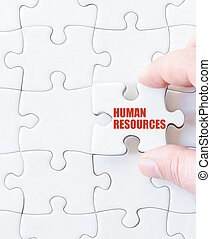 Missing jigsaw puzzle piece with words HUMAN RESOURCES