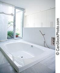 Modern white house bathroom bathtub with marble floor and courtyard skylight