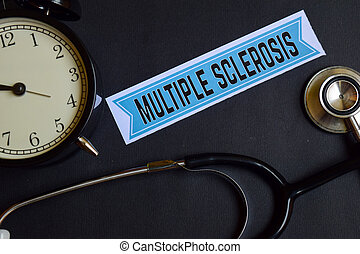 Multiple Sclerosis on the print paper with Healthcare Concept Inspiration. alarm clock, Black stethoscope.