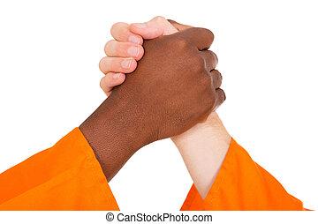 multiracial men holding hands