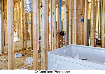New under construction bathroom with interior framing of bathroom