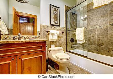 Nice bahroom with glass shower door.