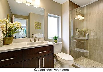 Nice bathroom with glass shower.