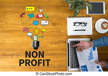 NON PROFIT Businessman working at office desk and using computer and objects, coffee, top view, with copy space