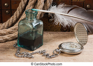 old pocket watch and inkwell