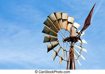 Old rusty windmill at rural farm