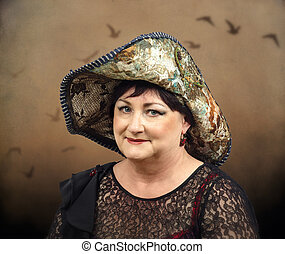 Old woman wearing tapestry hat