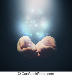 Open hands with magic particles. Holding, giving, showing concept. Selctive focus on fingers.