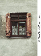 Opened window with shutters
