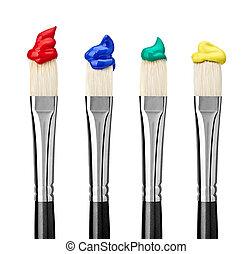 close up of paint brushes on white background