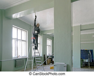 man standing on a ladder and paint the ceiling and walls of a spacious hall with columns ??????? ????? ?? ????????? ? ?????? ??????? ? ????? ??????????? ???? ? ???????