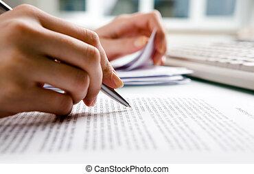 Close-up of secretary?s hands doing paperwork