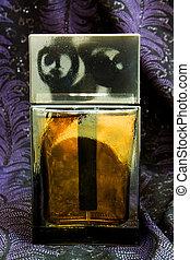 Perfume on a black background