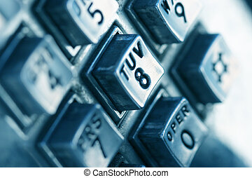 Close-up shot of phone numbers on a public telephone