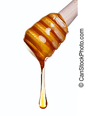 Photo of Honey dripping from a wooden dipper isolated on a white background.