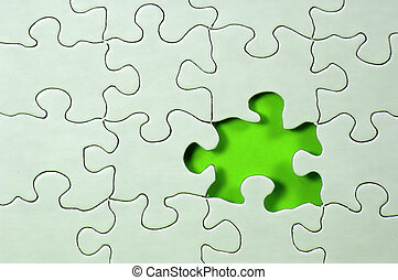 Photo of Puzzle With Missing Piece and Green Showing Through.