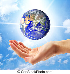 Planet Earth and human hand. Conceptual design.