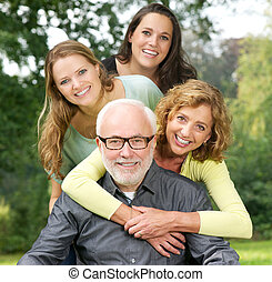 Closeup portrait of a happy family enjoying time together outdoors