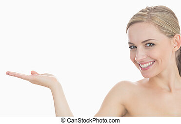 Portrait of beautiful young woman holding out open palm