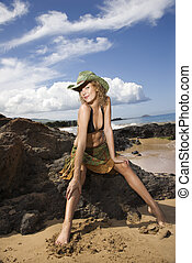 Portrait of young woman at beach.